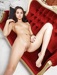 This wonderful brunette beauty has taken her top off to reveal her beautifully shaped natural boobs.