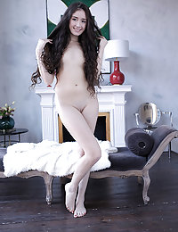 This adorable princess clearly has some fun getting naked and playing with her amazing body on the sofa.