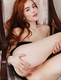 This shapely hottie sets eyes on fire with her hot red hair and her amazingly shaped body as she shows off.